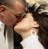 Young couple kissing. Man and woman kissing each other on the lips Royalty Free Stock Photos
