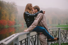 Young couple kissing in autumn park Royalty Free Stock Photo