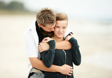 Young couple kissing on beach Stock Photography
