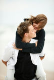 Young couple kissing on beach Royalty Free Stock Photo