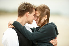 Young couple kissing on beach Royalty Free Stock Photography