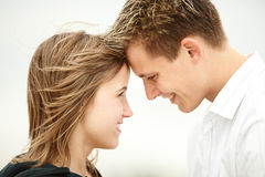 Young couple kissing on beach Royalty Free Stock Images