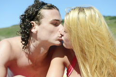 Young couple kissing on the beach Stock Photo