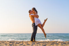 Young couple kissing at the beach. Young couple kissing  at the beach in late afternoon Stock Photos