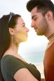 Young couple kissing on the beach Stock Images