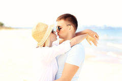 Young couple kissing at the beach. A picture of a young romantic couple kissing at the beach Royalty Free Stock Photos