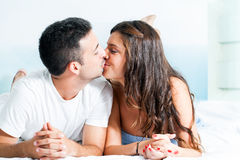 Young couple kissing in bedroom. Stock Photo
