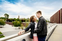 Young couple kissing on the bridge. Stock Image