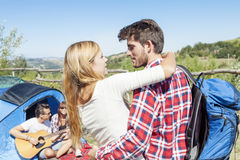 Young couple kissing in a camping Royalty Free Stock Photography