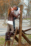 Young couple kissing on the children playground Stock Images