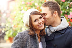 Young couple kissing in the city. Picture of happy couple kissing in the city stock photography