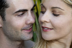 Young couple almost kissing close together looking at Stock Image