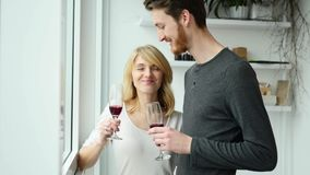 Young couple kissing and drinking red wine stock video footage