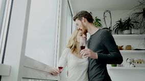 Young couple kissing and drinking red wine stock video
