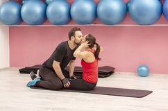 Young Couple Kissing in a Gym stock images