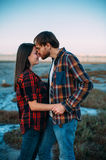 Young couple kissing and hugging Stock Photography