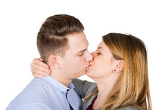 Young couple kissing - isolated Royalty Free Stock Photography