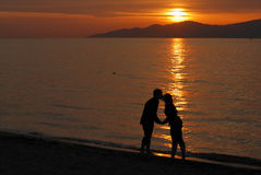 Young couple kissing on Jericho beach Royalty Free Stock Images