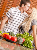 Young Couple Kissing in Kitchen Royalty Free Stock Photos