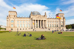 Young couple kissing on a meadow infront of Reichstag building in Berlin, Germany. Stock Image