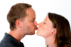 Young couple is kissing Royalty Free Stock Image