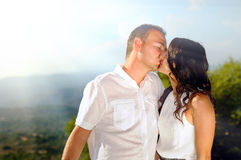 Young couple kissing in the mountains Royalty Free Stock Images