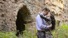 Young couple kissing on nature. On the Fortress background stock video