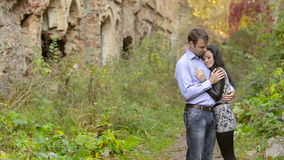 Young couple kissing on nature. On the Fortress background stock footage