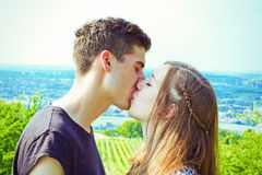 Young couple kissing in nature Stock Images