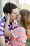 Young couple kissing near graffiti background. Royalty Free Stock Images