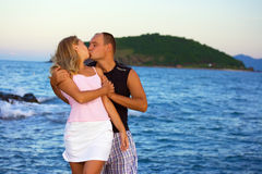 Young couple kissing near the ocean Royalty Free Stock Images