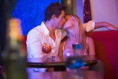 Young couple kissing in a nightclub Royalty Free Stock Image