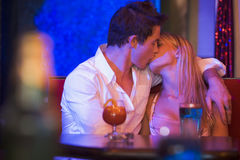 Young couple kissing in a nightclub stock images