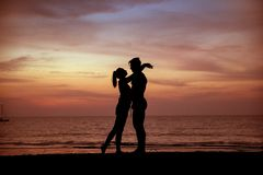 Young Couple Kissing On A Tropical Beach, Sunset In Background Royalty Free Stock Images