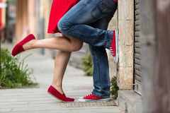 Young couple kissing outdoor. Male and female legs Stock Photos