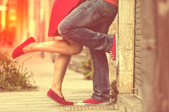 Young couple kissing outdoor. Male and female legs. Cross proces Stock Photography