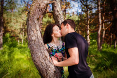 Young couple kissing outdoor in summer sun light. Kiss love date color evening teen. Stock Images