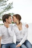 Young couple kissing outdoors Royalty Free Stock Images