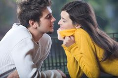 Young couple kissing, outdoors. Young happy couple kissing, outdoors Royalty Free Stock Photos