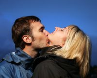 Young couple kissing outdoors Royalty Free Stock Photos
