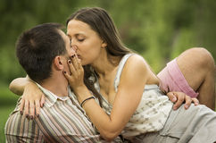 Young couple kissing in park Royalty Free Stock Photo