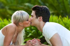 Young couple kissing in park. Royalty Free Stock Image