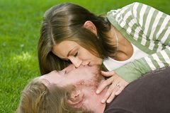 Young couple kissing in the Park Stock Photos