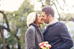 Young couple kissing in the park. Picture of young couple kissing in the park royalty free stock image