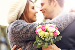 Young couple kissing in the park Stock Photography
