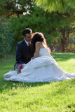Young couple kissing in the park after wedding Royalty Free Stock Photo
