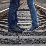 Young couple kissing at railways rails Royalty Free Stock Photos