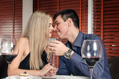 Young couple kissing in restaurant Royalty Free Stock Photography