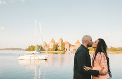 Young couple kissing at seaside on vacation in Europe Stock Images