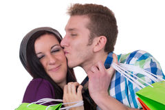 Young couple kissing while shopping, love topic Stock Image